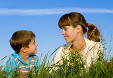 Mother with a son on  the meadow Stock Photos
