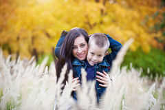 Mother and son on the  meadow Stock Image