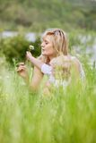 Mother and Son in Meadow Making Wishes Royalty Free Stock Photo