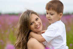 Mother and son in meadow outdoor Royalty Free Stock Photos
