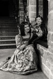 Mother and son in medieval costumes Stock Image