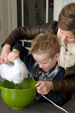 Mother and son mixing the dough. Mother and son are mixing the dough for the cake Stock Photo