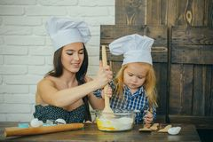 Mother and son mixing flour and eggs in bowl royalty free stock photo