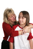 Mother Son Moment. A mother trying to give her skeptical son a hug. Isolated Royalty Free Stock Photography