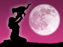 Mother and son in the moon Stock Images