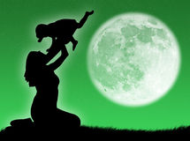 Mother and son in the moon Stock Image