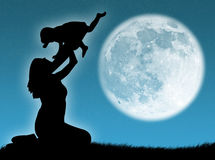 Mother and son in the moon Stock Photography