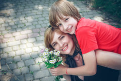 Mother and son on Mother's Day. Spring portrait of mother and son on Mother's Day Stock Photo