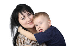 Mother and son. Motherhood and son's love - Little boy embraces black haired women isolated on white background Stock Photo
