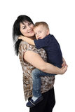 Mother with son. Motherhood and son's love - Little boy embraces black haired women which holds him on hands isolated on white background stock images