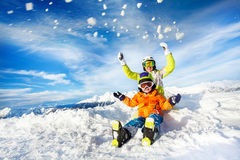 Mother and son on the mountain happy throw snow Royalty Free Stock Image