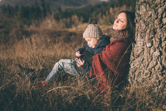 Mother and son in nature Stock Photos