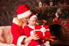 Mother and son near Christmas fireplace Royalty Free Stock Photography