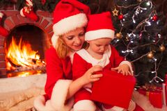 Mother and son near Christmas fireplace Royalty Free Stock Photo