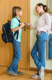 Mother and son near door Stock Image