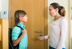 Mother and son near door Royalty Free Stock Image