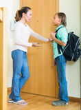 Mother and son near door Stock Photography