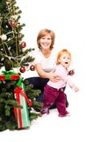 Mother with a son near a new-year tree Royalty Free Stock Photography