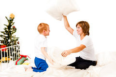 Mother with a son near a new-year tree Royalty Free Stock Photo