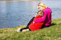 Mother and son near the river Stock Photography