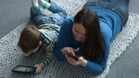 Mother and son networking with digital devices stock video