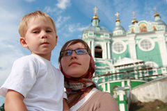 Mother and son next to the church. Stock Images