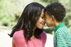 Mother and son nuzzling. Stock Images