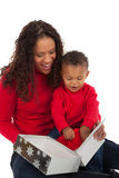 Mother and Son Open Christmas Gift Box Stock Photo