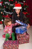 Mother and son opening Christmas presents Royalty Free Stock Image