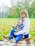 Mother and son outdoor Stock Images
