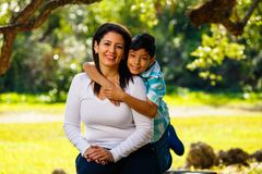 Mother and son outdoor portrait. Mother and son outdoor lifestyle portrait in a park setting Royalty Free Stock Images