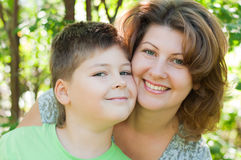 Mother and son outdoors Stock Images