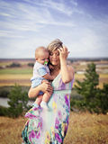 A mother with son outdoors Royalty Free Stock Images