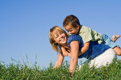 Mother and son outdoors. In summertime Royalty Free Stock Photo
