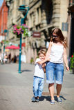 Mother and son outdoors at city Royalty Free Stock Images