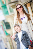 Mother and son outdoors in city Stock Images