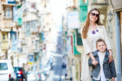 Mother and son outdoors in city Royalty Free Stock Photos