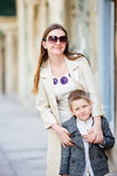 Mother and son outdoors in city Stock Photo