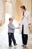 Mother and son outdoors in city Royalty Free Stock Image