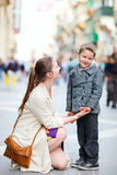 Mother and son outdoors in city Royalty Free Stock Images