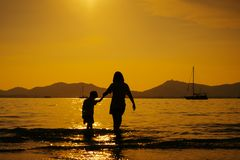 A mother and son in outdoors at sunset with copy space royalty free stock image