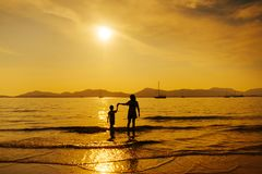 A mother and son in outdoors at sunset with copy space stock photography