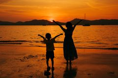 A mother and son in outdoors at sunset with copy space stock photo