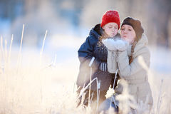 Mother and son outdoors at winter Royalty Free Stock Photos