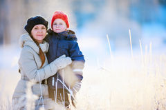 Mother and son outdoors at winter Stock Images