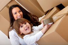 Mother and son packing Royalty Free Stock Photos