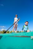 Mother and son on a paddle board royalty free stock images