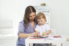 Mother and son paint Stock Image