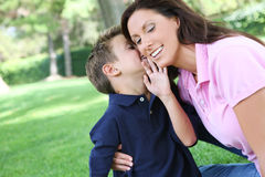 Mother and Son in Park. A mother and son having fun while playing in the park Stock Images