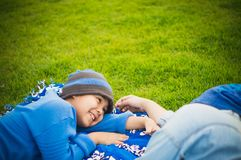 Mother, son in the park, football field and lawn. stock image